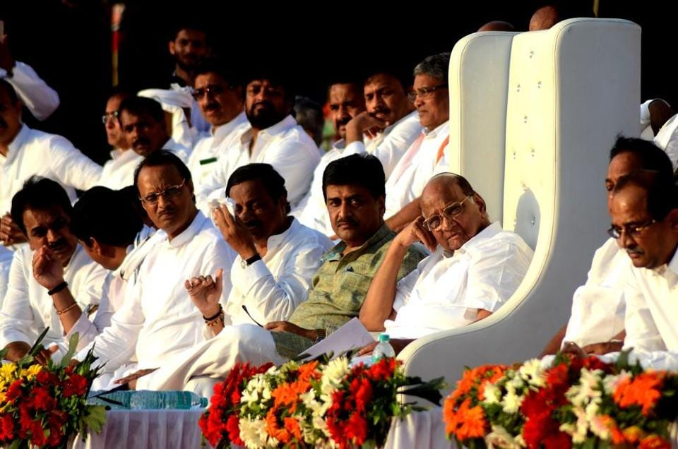 NCP chief Sharad Pawar (extreme right) with Congress leader Ashok Chavan (second from right) and NCP leaders Sunil Tatkare and Ajit Pawar (extreme left) at a rally in Panvel.