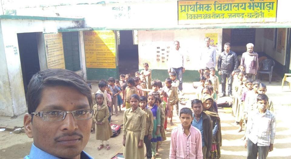 A teacher clicks a selfie with students.