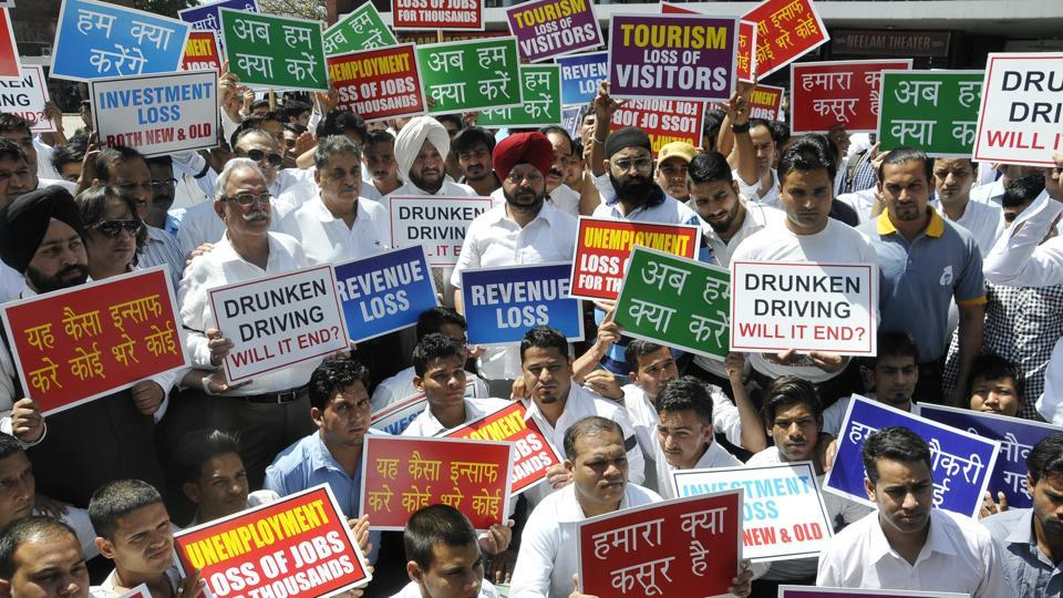 People associated with the hospitality industry protesting at the Sector17 Plaza in Chandigarh on Monday.