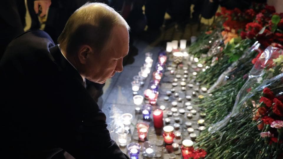 Russian President Vladimir Putin places flowers in memory of victims of the blast in the Saint Petersburg metro at Technological Institute station on April 3.