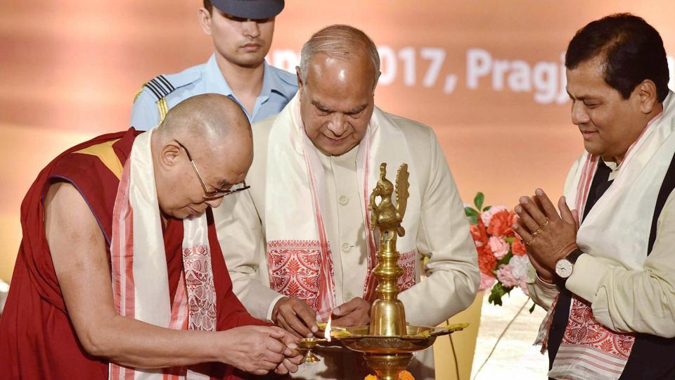 Tibetan spiritual leader Dalai Lama with Assam Governor Banwarilal Purohit and state Chief Minister Sarbananda Sonowal, lighting the lamp during a function in Guwahati . The Dalai Lama on April 1 started  his  tour of Assam and Arunachal Pradesh – which China claims is part of south Tibet.   (PTI)