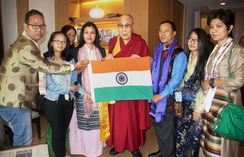 Tibetian Spiritual leader, the Dalai Lama presenting Indian National Flag to Ace mountaineer from Arunachal Pradesh Anshu Jamsenpa during the flag off ceremony of her Double Ascent Mt Everest Expedition 2017 in Guwahati. (PTI)