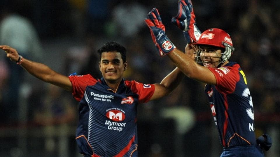 Pawan Negi (L) and Naman Ojha celebrate a wicket during the IPL Twenty20 first playoff match between Delhi Daredevils and Kolkata Knight Riders in Pune on May 22, 2012.