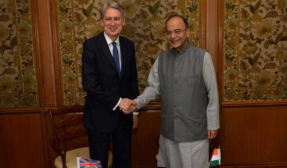Indian Finance Minister Arun Jaitley (R) and British Chancellor Philip Hammond shake hands ahead of a meeting in New Delhi on April 4, 2017.