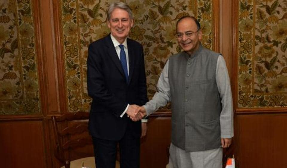 Indian finance minister Arun Jaitley (right) and Britiain's chancellor of the exchequer Philip Hammond shake hands ahead of a meeting in New Delhi on April 4, 2017.