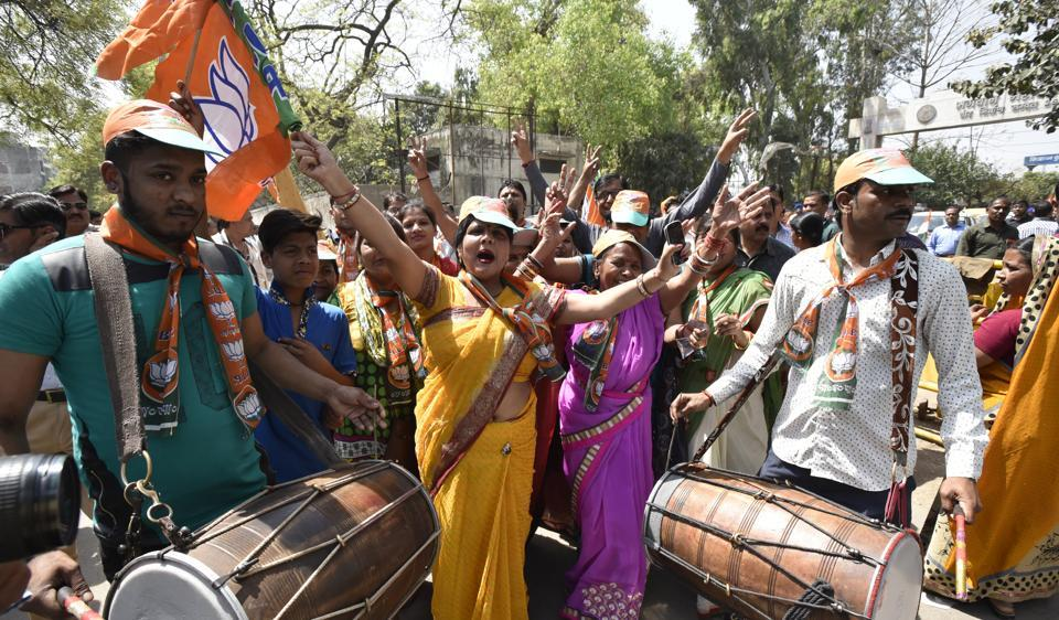 BJP workers celebrate after their leader filed the nomintation for MCD elections at Geeta Colony in east Delhi.