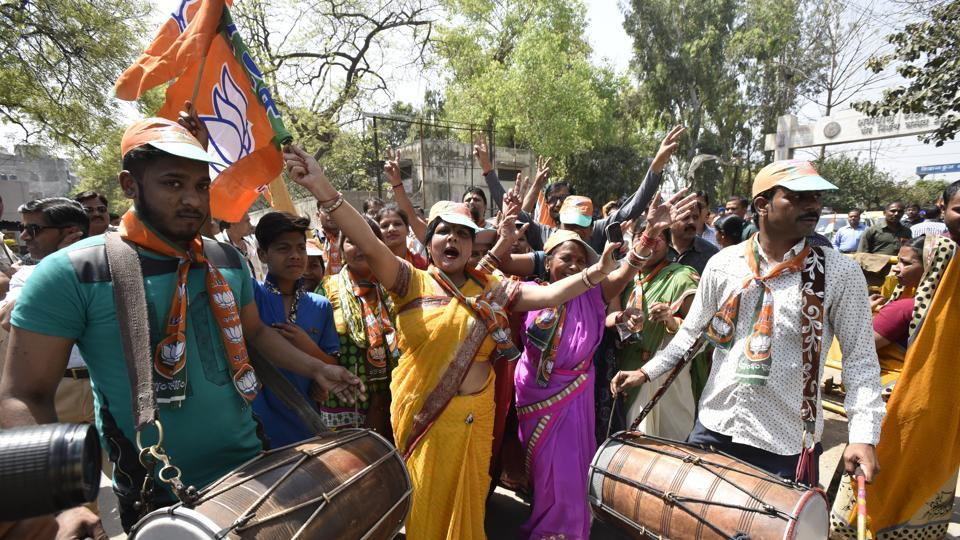 BJP worker celebrate out side the DM office at Gita Colony in New Delhi on  Monday, the last day of filing election papers.