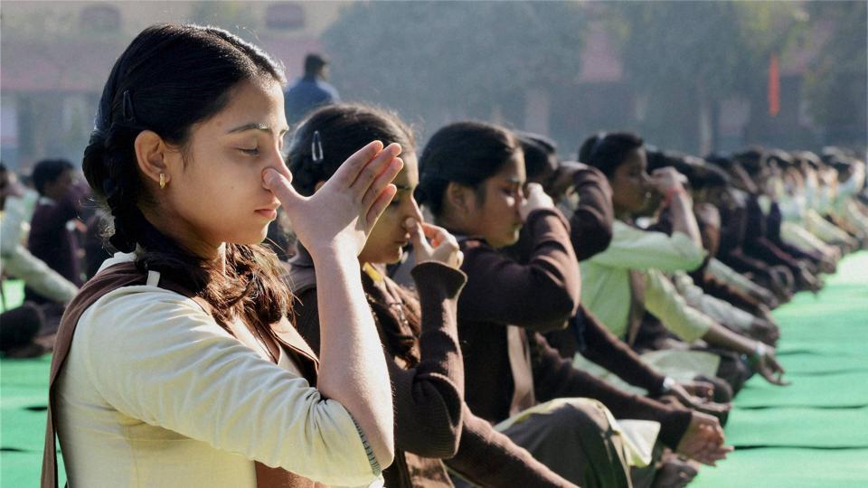School children perform Yoga during a programme on the birth anniversary of Swami Vivekananda in Jabalpur.