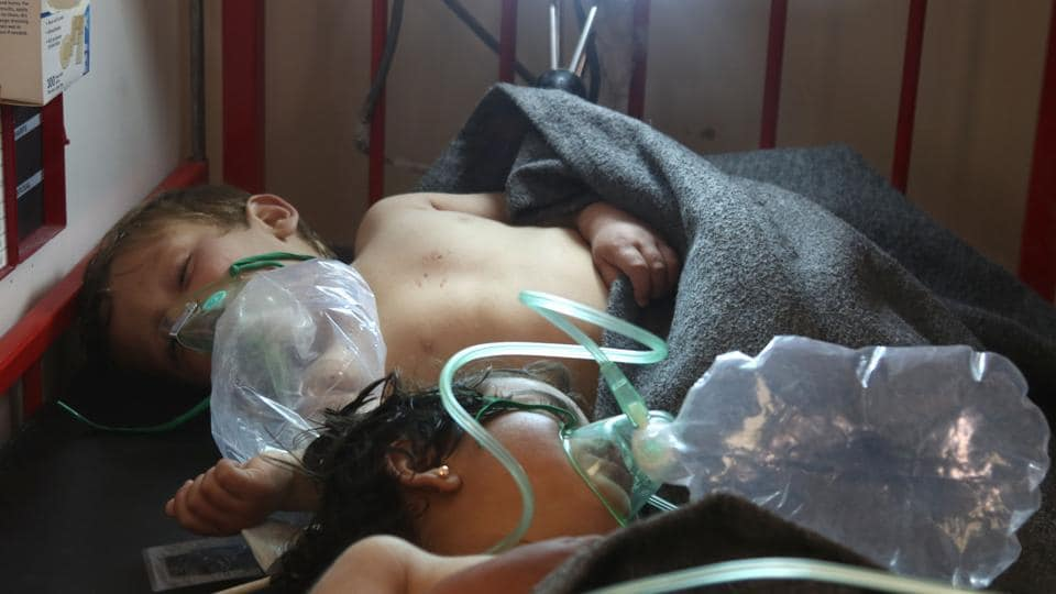 Syrian children receive treatment at a small hospital in the town of Maaret al-Noman following a suspected toxic gas attack in Khan Sheikhun, a nearby rebel-held town in Syria's northwestern Idlib province, on April 4, 2017.