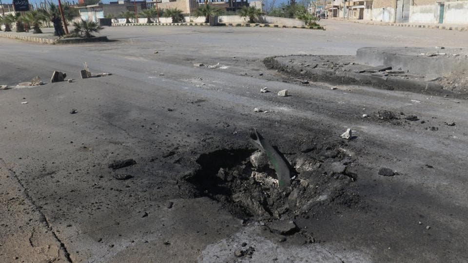 A crater is seen at the site of an airstrike, after what rescue workers described as a suspected gas attack in the town of Khan Sheikhoun in rebel-held Idlib, Syria . (Ammar Abdullah / REUTERS)