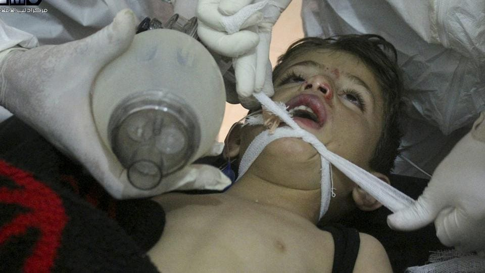 This photo provided by the Syrian anti-government activist group Edlib Media Center, which has been authenticated based on its contents and other AP reporting, shows Syrian doctors treating a child following a suspected chemical attack, at a makeshift hospital, in the town of Khan Sheikhoun, northern Idlib province, Syria.