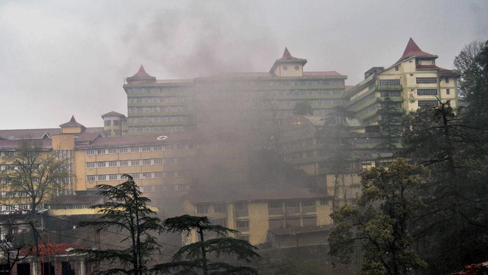 Smoke billowing out of a building after it was struck by lightning, triggering fire, in Shimla on Wednesday.