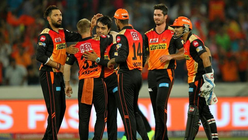 Sunrisers Hyderabad players celebrate after the dismissal of a Royal Challengers Bangalore batsman during the opening