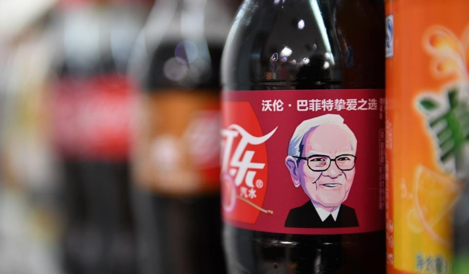 A Cherry Coke bottle featuring an image of US investor Warren Buffet is seen on a shelf at a convenience store in Beijing on April 5, 2017.
