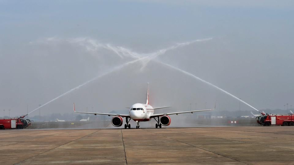 First Airbus 320 neo plane receiving a water cannon salute at Avionics Complex, Air India hanger IGI in New Delhi.