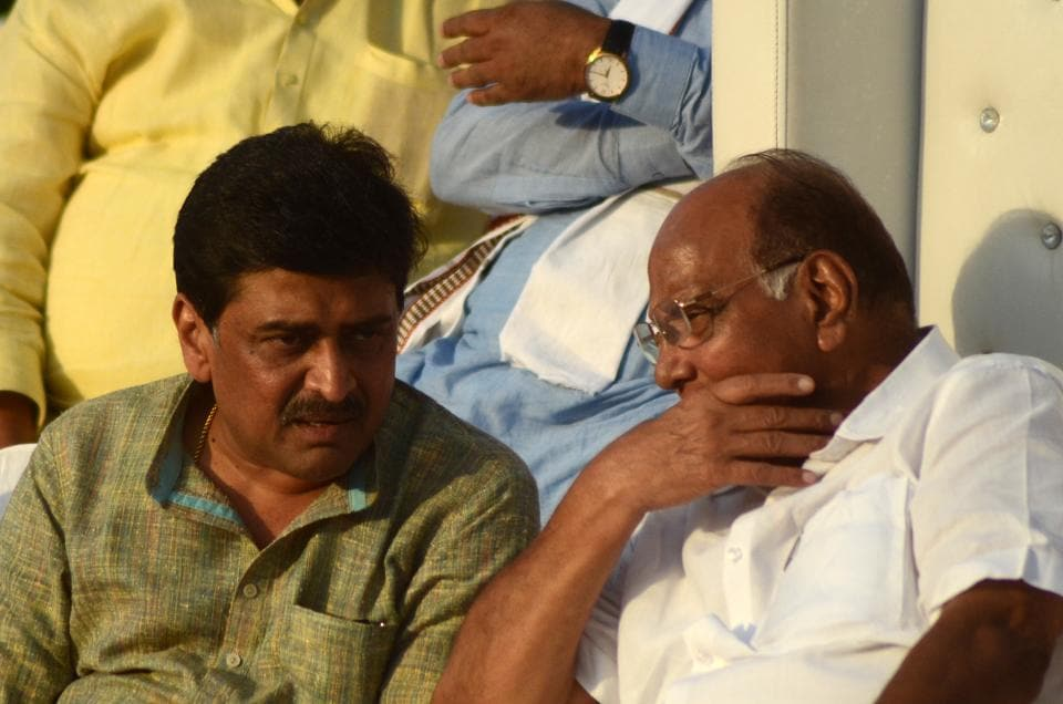 NCP chief Sharad Pawar with Congress leader Ashok Chavan at a rally in Panvel on Tuesday.