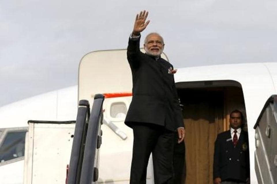 India's Prime Minister Narendra Modi waves as he boards a plane.