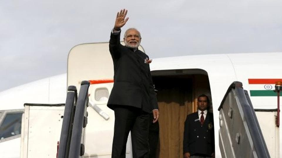 India's Prime Minister Narendra Modi waves as he boards a plane after his trip to Kabul, Afghanistan December 25, 2015.