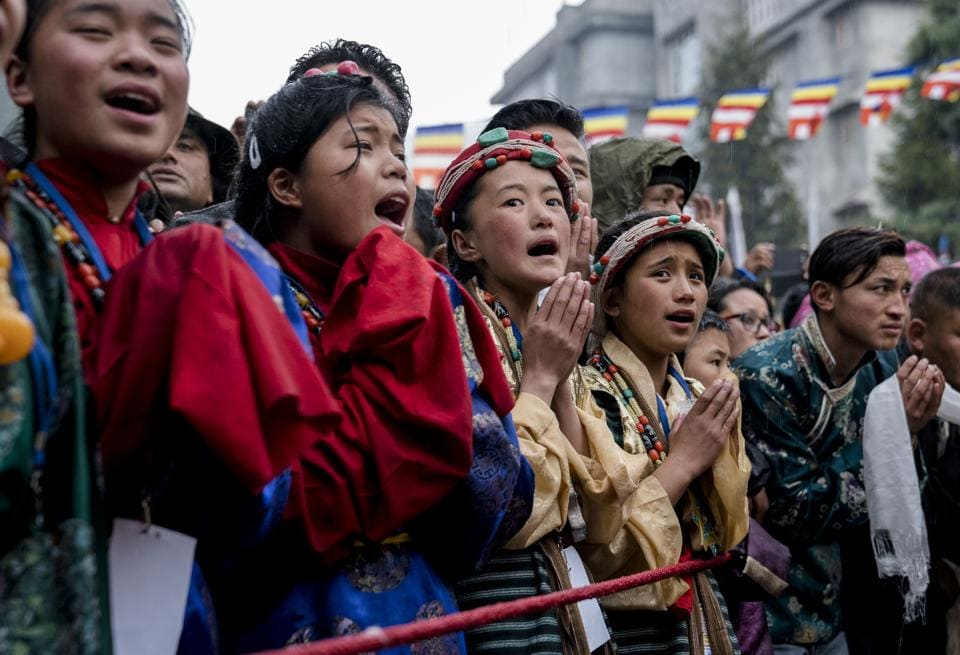 Devotees greet the Dalai Lama as he arrives at the Thubchok Gatsel Ling Monastery in Bomdila in Arunachal Pradesh.  (Tenzin Choejor / AP)