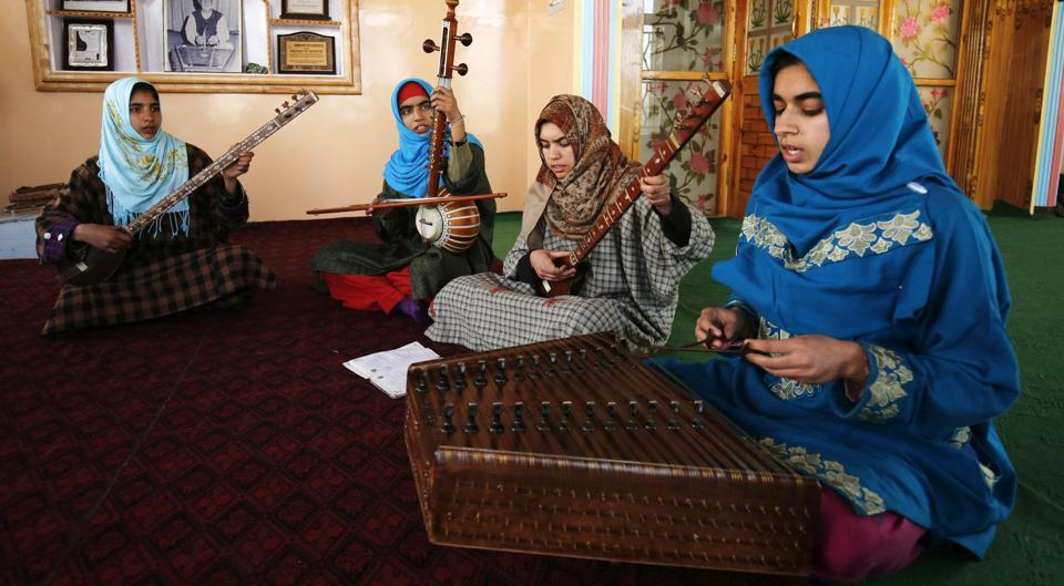 Thousands of people in the Muslim-majority region follow Sufism, a mystical branch of Islam whose adherents seek spiritual communion through music and dance . The songs, which use the lyrics of old Kashmiri- and Persian-language devotional poetry, date back to the 15th century. But they have evolved as a uniquely male tradition, sung by men and handed down through the male line of the family. (PARVAIZ BUKHARI / AFP)