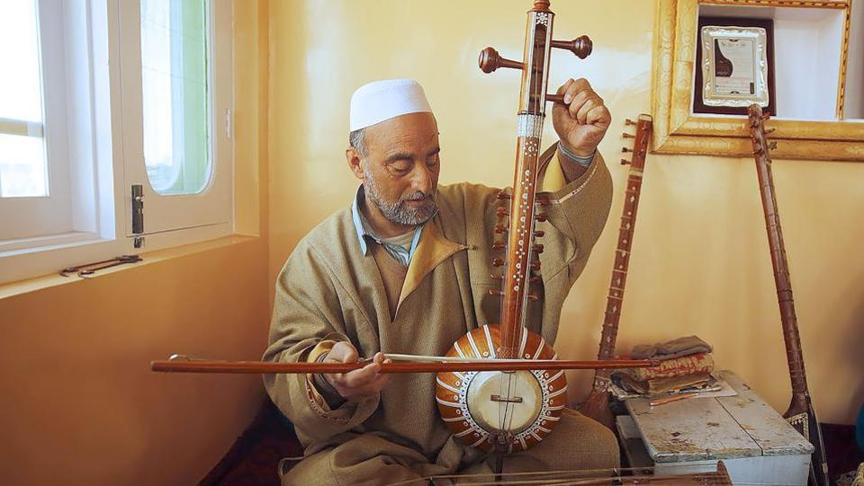 Sheikh began teaching young Kashmiris in a bid to preserve the Sufi musical tradition of the picturesque Himalayan region, which has been divided between India and Pakistan since partition but is claimed by both countries. (PARVAIZ BUKHARI / AFP)