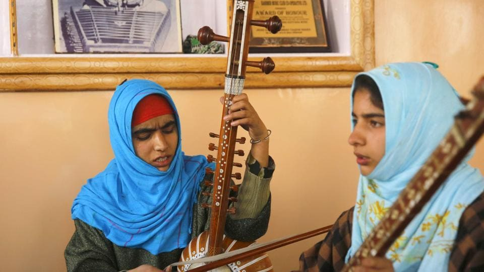 Kashmiri Muslim girls play instruments and sing Sufi music under the tutelage of music teacher, Muhammad Yaqoob Sheikh, on the outskirts of Srinagar. (PARVAIZ BUKHARI / AFP)