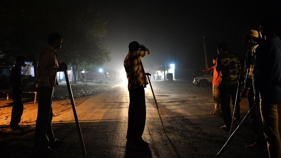 Volunteers of the Gau Raksha Dal (cow protection squad) prepare to inspect trucks on a highway in Taranagar,  Rajasthan.