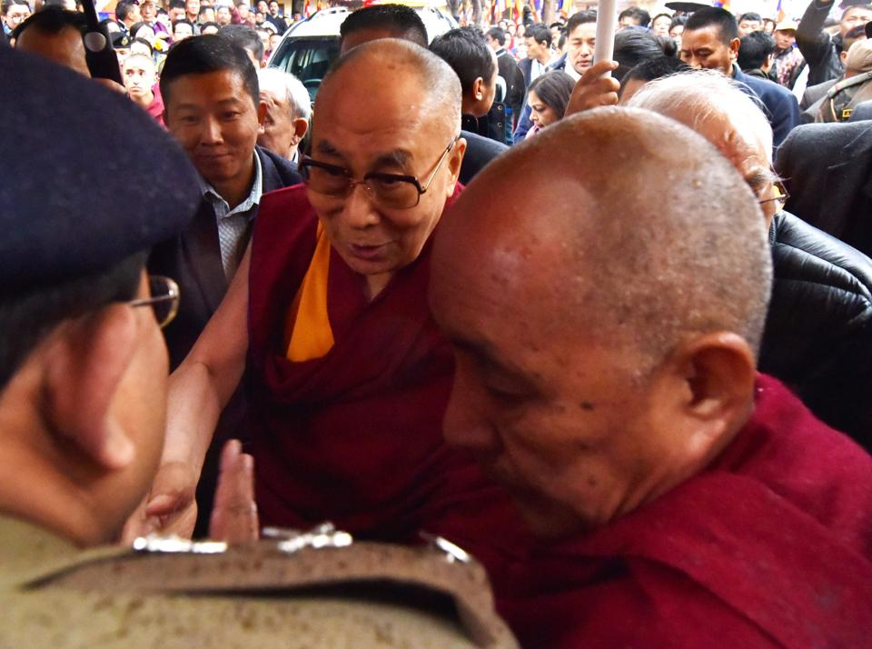 Exiled Tibetan spiritual leader the Dalai Lama meets Buddhist followers at the Thubchog Gatsel Ling Monastery in Bomdila . (Biju BORO / AFP)