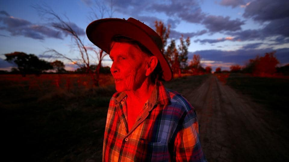 May McKeown watches the sunset on her 6000 acre (2400 hectare) property of 'Long View' near the town of Come-by-Chance, located over 700 kilometres north-west of Sydney in Australia. McKeown, aged 78, lives and works on her property mostly alone as her son is constantly travelling. She daily inspects the property and hand-feeds her cattle, writing poems in her spare time about her lonely life on the flat north-west plains.  (David Gray/REUTERS)