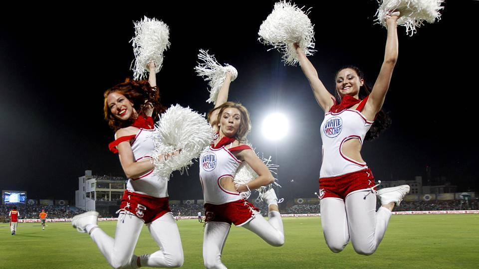 Cheerleaders for Kings XI Punjab perform during the IPL season of 2013.  No one goes regularly to the Staples Centre in Los Angeles for the cheerleaders, or takes the train from central London to Wimbledon because Cliff Richard might sing a few oldies if it's raining.These may be welcome bonuses, but the reason one makes these trips is a chance to witness the pinnacle of sport.
