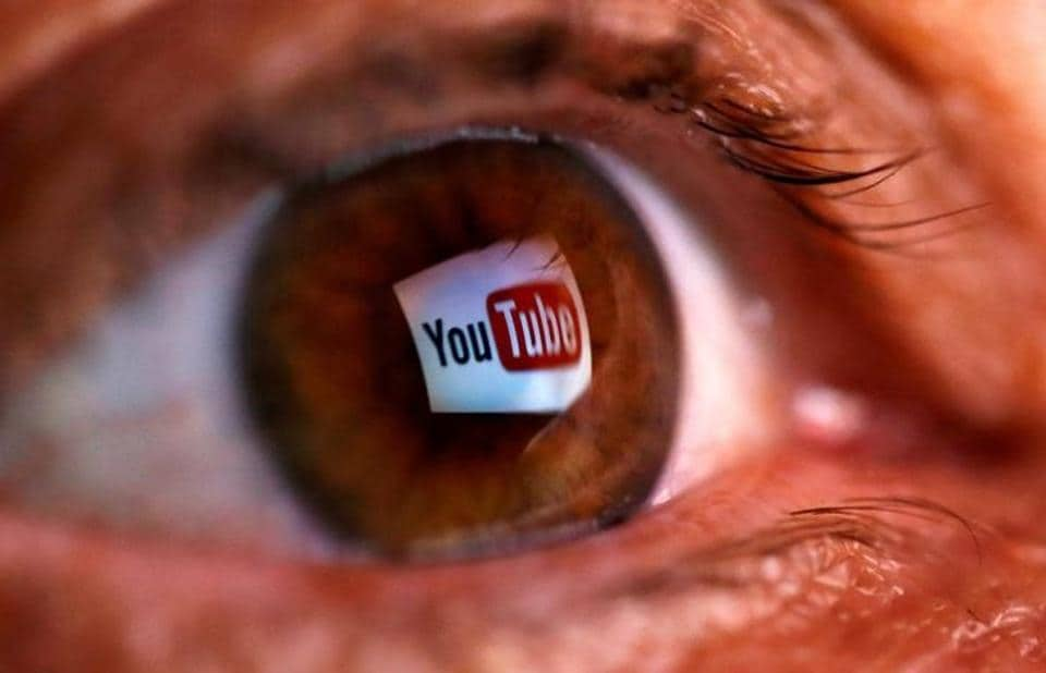 A picture illustration shows a YouTube logo reflected in a person's eye.