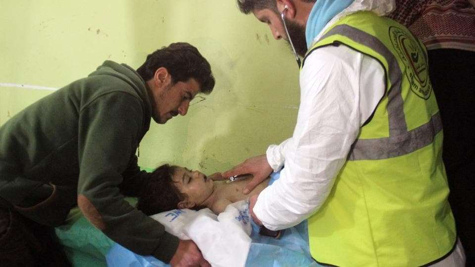 An unconscious Syrian child receives treatment at a hospital in Khan Sheikhun, a rebel-held town in the northwestern Syrian Idlib province, following a suspected toxic gas attack . (Omar haj kadour / AFP)