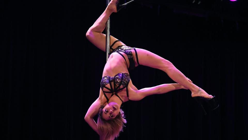 Claudia Renee competes during the Amateur Division Competition at the 5th Annual US Pole Dance Championship at the Symphony Space Theater in New York City. (TIMOTHY A. CLARY / AFP)