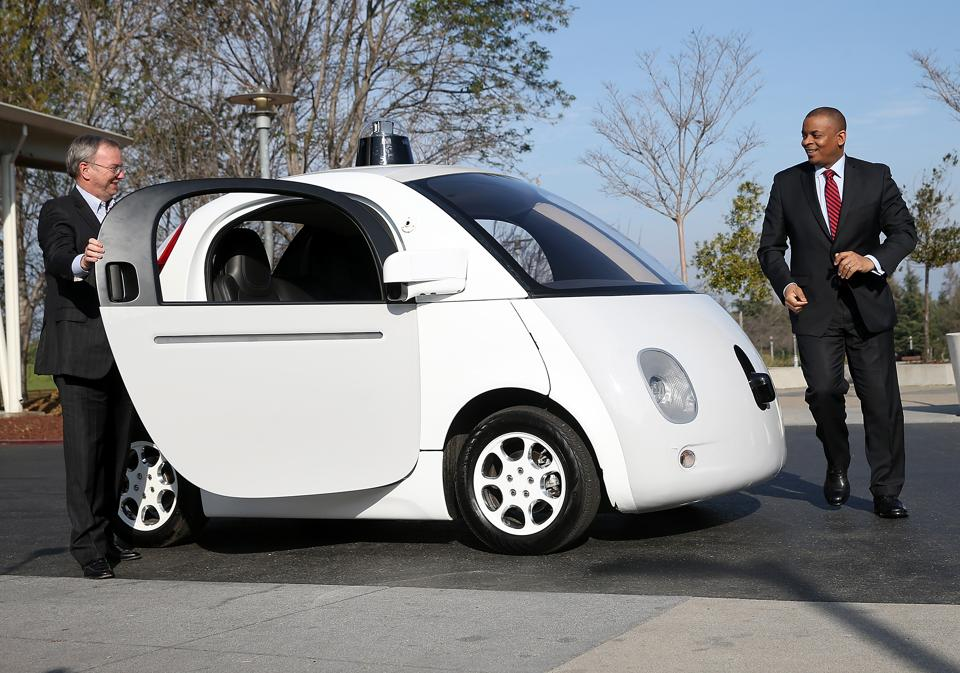 Driving innovation:US Transportation Secretary Anthony Foxx (R) and Google Chairman Eric Schmidt (L) get out of a Google self-driving car at the Google headquarters on February 2, 2015 in Mountain View, California.
