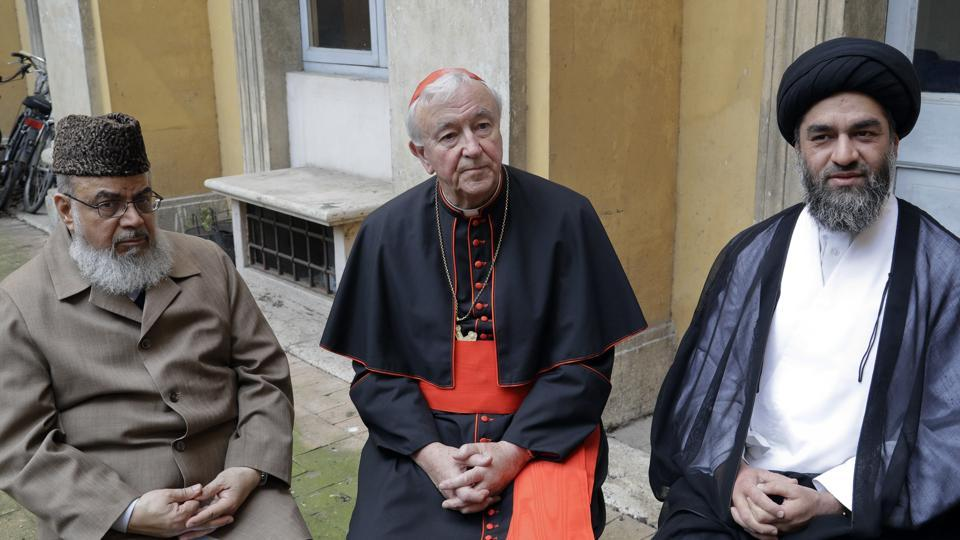 From left, Muhammad Shahid Raza, chairman of the British Muslim Forum, Cardinal Vincent Nichols, Archbishop of Westminster, and Ali Raza Rizvi at Rome's English College, Tuesday, April 4, 2017. Pope Francis is meeting with four British imams, part of his effort to give prominence and a platform to Muslim leaders who renounce using religion to justify violence.