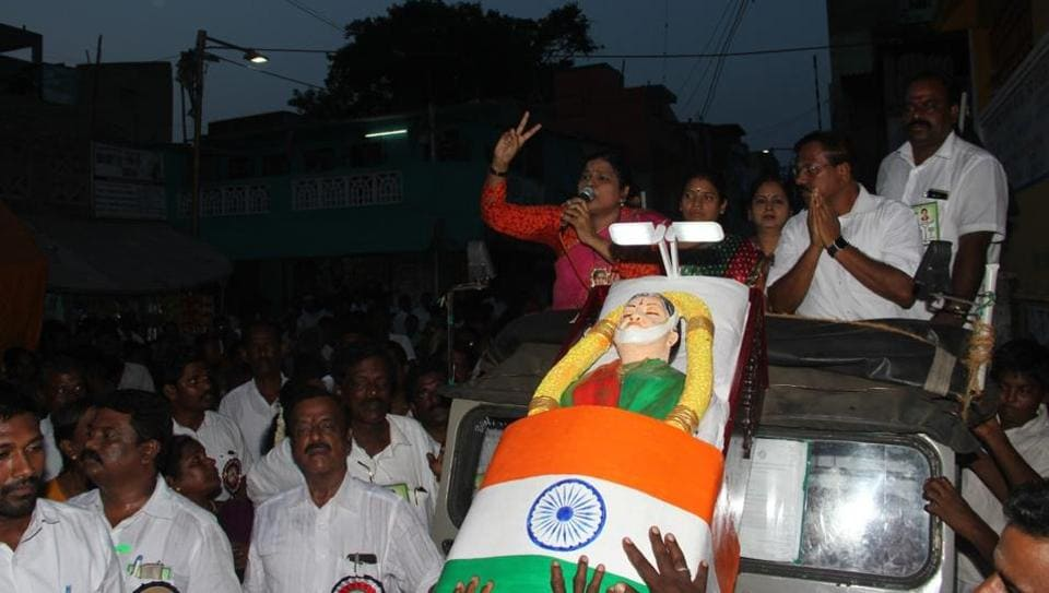 Party workers of the ruling AIADMK campaign using a dummy body resembling late former chief minister J Jayalalithaa on Thursday in Chennai.