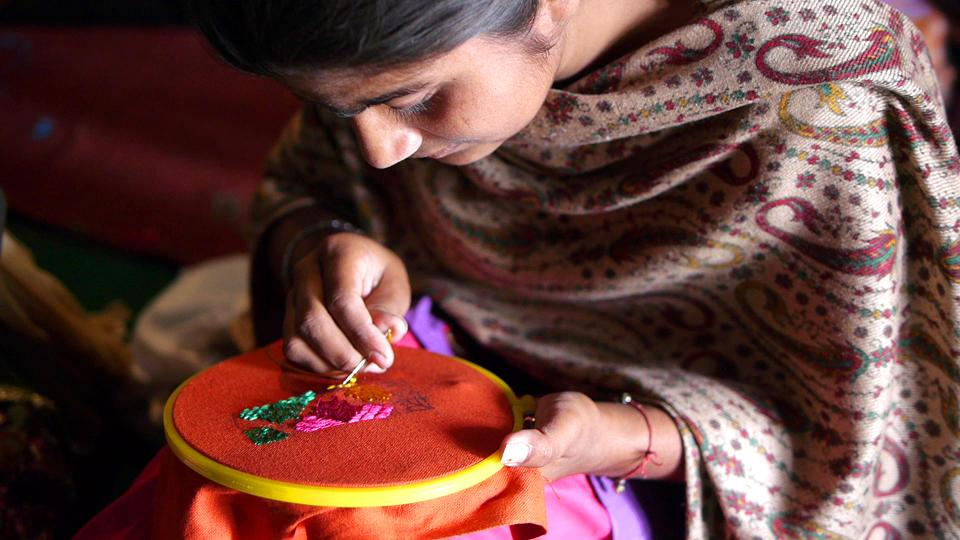 A woman from the Sangrur area of Punjab works on Sangrur bells that include Phulkari threadwork.