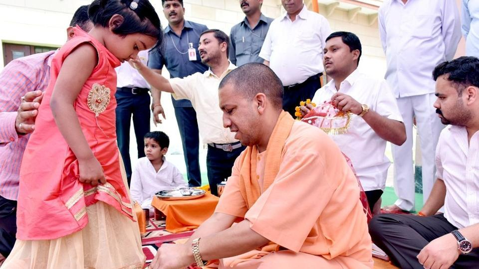 Chief minister Yogi Adityanath performing kanya pujan at his 5 KD residence in Lucknow on Wednesday.