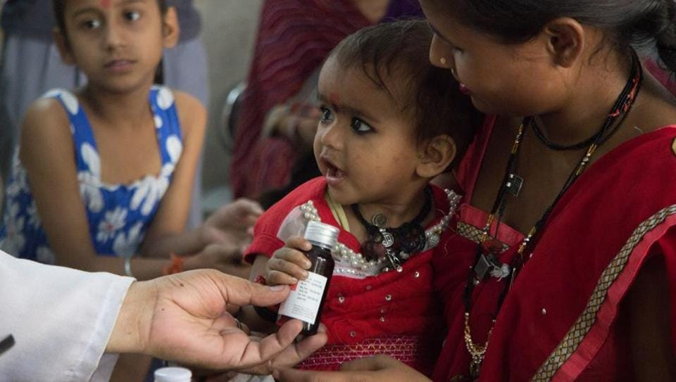 An infant accepts a bottle of medicine from a doctor at a Mohalla Clinic in Todapur village in Delhi. Infant mortality rate in India was forty per thousand live births, a very high rate, owed to very restricted access to neonatal care in rural areas. (Vageesh LalL/HT Photo)
