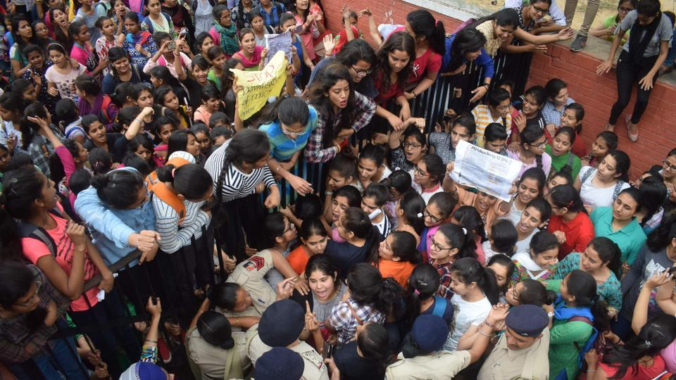 Students arguing with police personnel during a protest against Panjab University's fee hike at Government College for Girls, Sector 11, Chandigarh, on Wednesday.