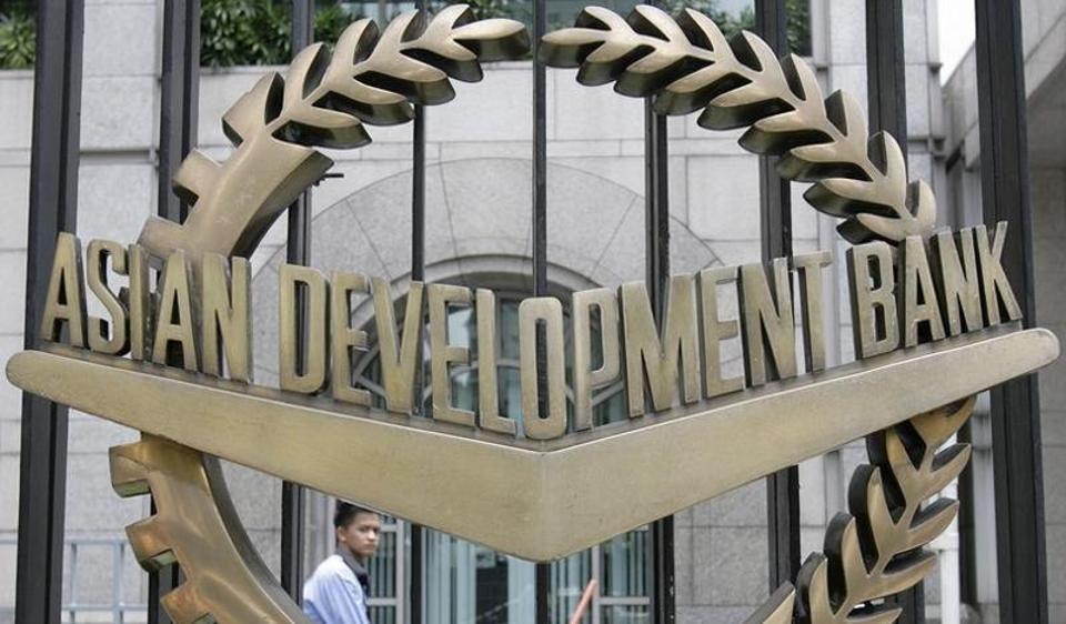 A worker walks past inside the Asian Development Bank (ADB) headquarters in Manila.
