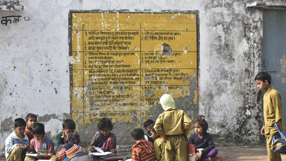 Students study in a government primary school in a village in Aligarh, UP.