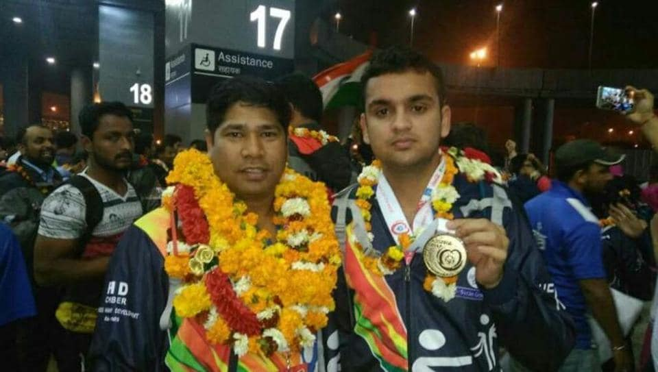Pankaj Soni (right) won the gold medal in floorball at the Special Olympics World Winter Games in Austria.
