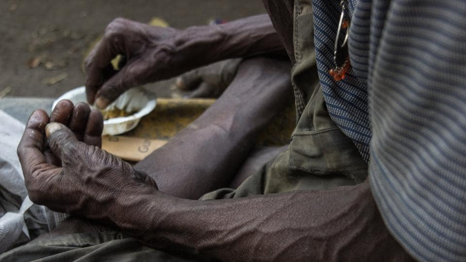 The hands of a man eating alms by the roadside. With 25% of all hungry people of the world living in India, malnutrition plagues the country. An estimated 194.6 million people in India are undernourished with 44% of children underweight and 72% infants anaemic. (Vageesh Lall/ht photo)