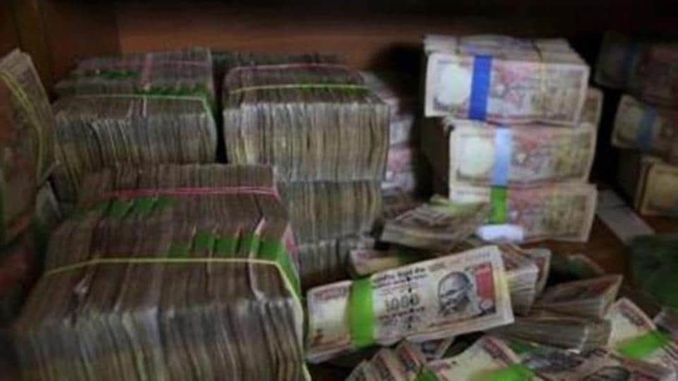Discontinued Indian currency notes of 1,000 denomination seen after they were deposited at a bank in Bangalore.