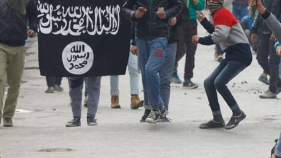 An ISIS flag being waved  during a protest.