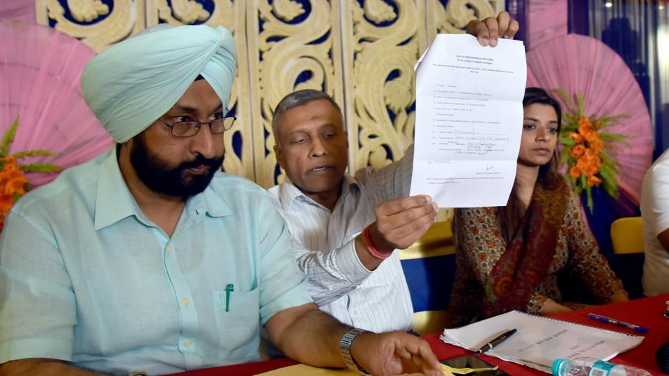 Excise and taxation officials during the auction of liquor vends in Ludhiana on Wednesday.
