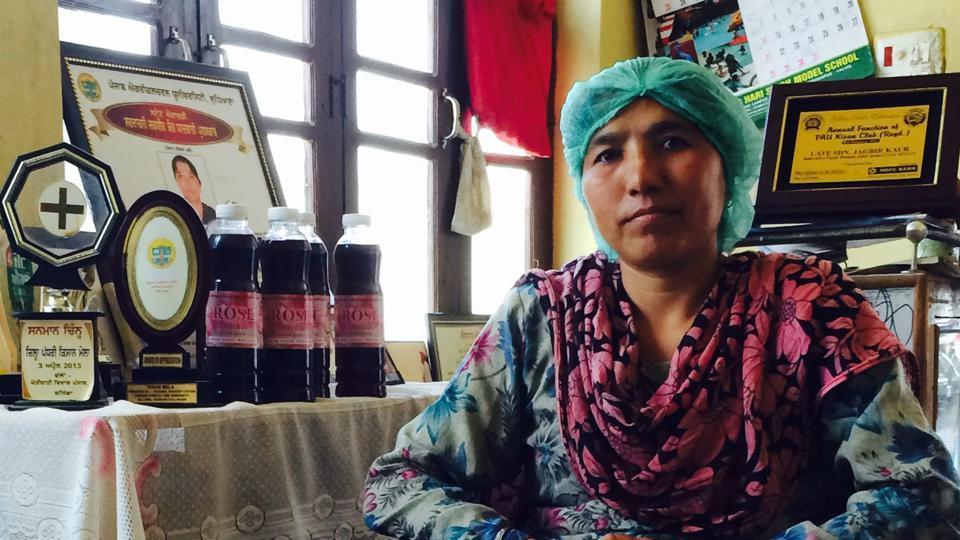 Vinod Kumari, founder president of the self-help group 'Sandhya', with bottles of rose 'sharbat' at Maili village in Hoshiarpur.