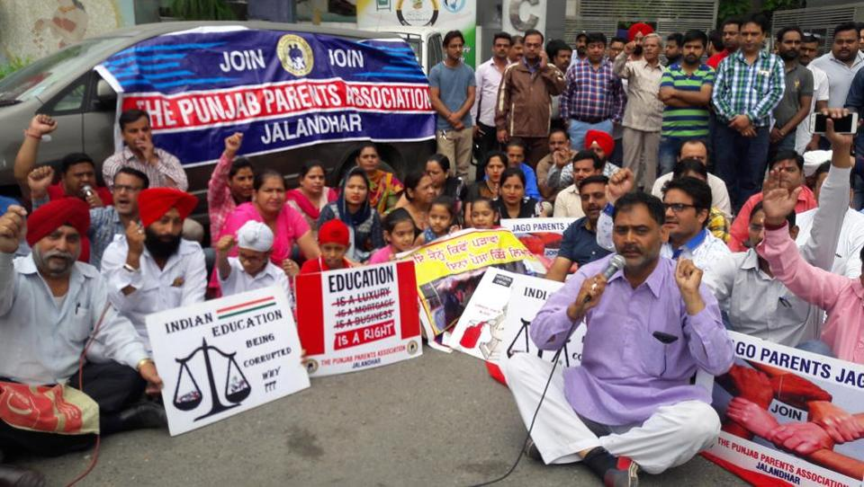 Members of a parents association protesting against private schools in Jalandhar on Wednesday.