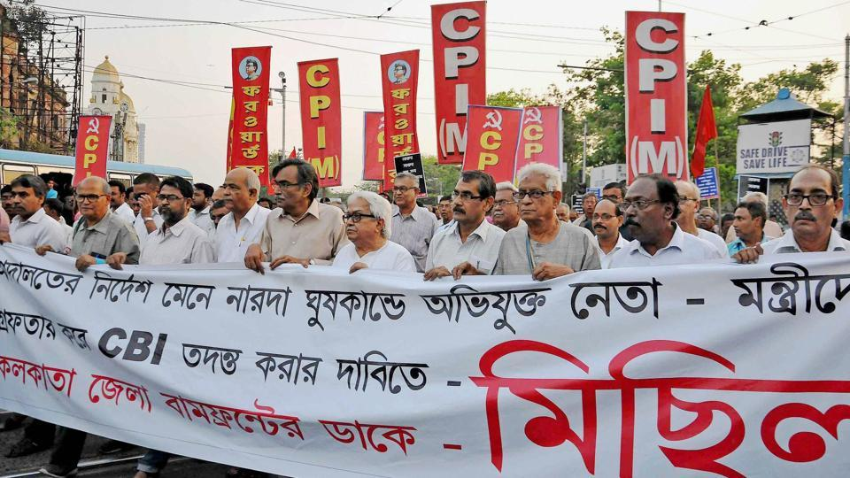 Left Front Chairman Biman Bose and CPI(M) Politburo member and party State Secretary Surya Kanta Mishra with other Left leaders partcipate in a rally demanding arrest of Narada sting case accused Trinamool Congress leaders, in Kolkata.
